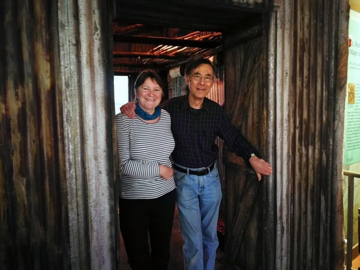 Man and woman standing in doorway